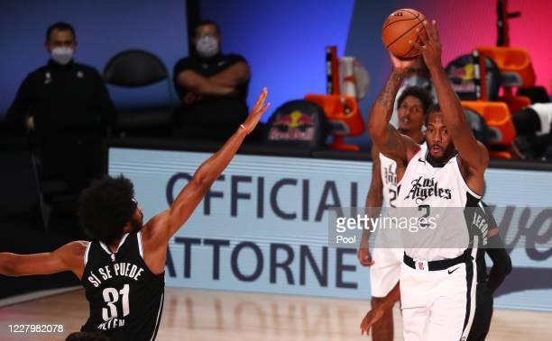 Kawhi Leonard of the LA Clippers is defended by Jarrett Allen of the Brooklyn Nets in the first half of a NBA basketball game at AdventHealth Arena...