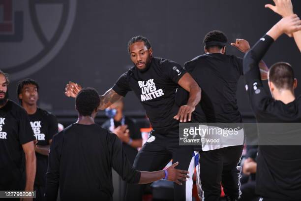 Kawhi Leonard of the LA Clippers jumps up next to a teammate before the game against the Brooklyn Nets on August 9 2020 at AdventHealth Arena in...