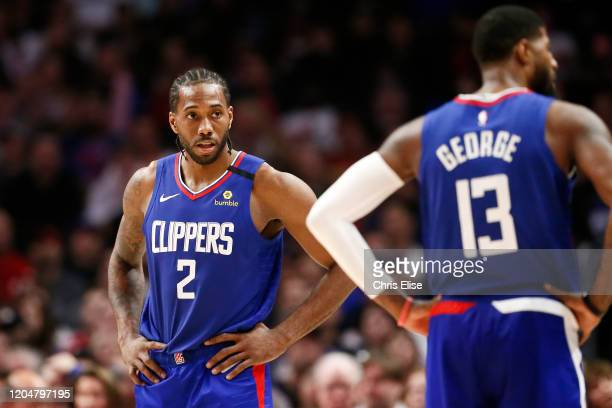 Kawhi Leonard of the LA Clippers looks at Paul George of the LA Clippers during a game at the Staples Center on March 1 2020 in Los Angeles CA NOTE...