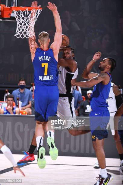 Kawhi Leonard of the LA Clippers looks to pass against the Denver Nuggets on August 12 2020 at the AdventHealth Arena at in Orlando Florida NOTE TO...