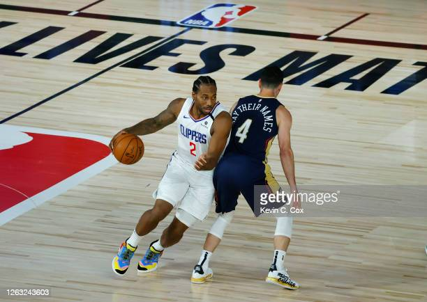 Kawhi Leonard of the LA Clippers moves around JJ Redick of the New Orleans Pelicans at HP Field House at ESPN Wide World Of Sports Complex on August...