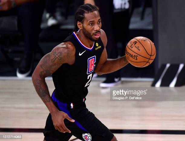 Kawhi Leonard of the LA Clippers of the LA Clippers dribbles the ball during the third quarter against the Denver Nuggets in Game Seven of the...