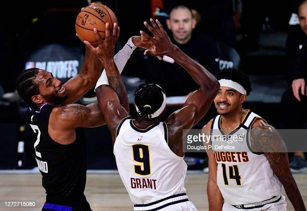 Kawhi Leonard of the LA Clippers of the LA Clippers drives the ball against Jerami Grant of the Denver Nuggets during the third quarter in Game Seven...