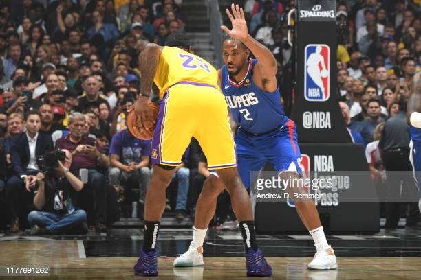 Kawhi Leonard of the LA Clippers plays defense against LeBron James of the Los Angeles Lakers on October 22 2019 at STAPLES Center in Los Angeles...