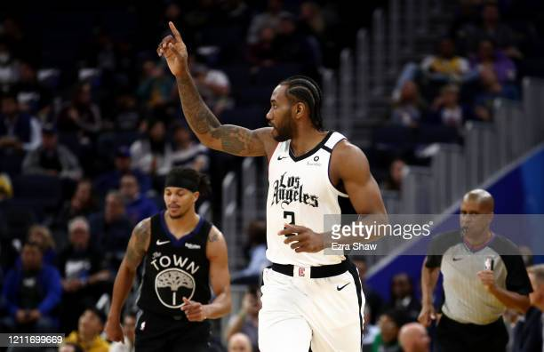 Kawhi Leonard of the LA Clippers reacts after making a basket tate Warriors at Chase Center on March 10, 2020 in San Francisco, California. NOTE TO...