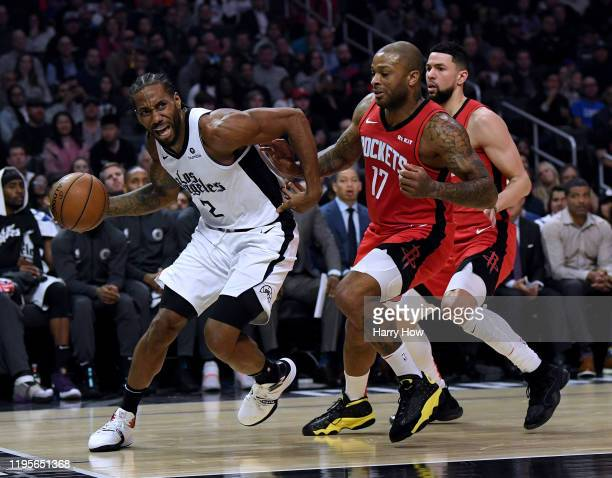 Kawhi Leonard of the LA Clippers reacts as he dribbles past la17#2 and Austin Rivers of the Houston Rockets during a 122-117 Rockets win at Staples...