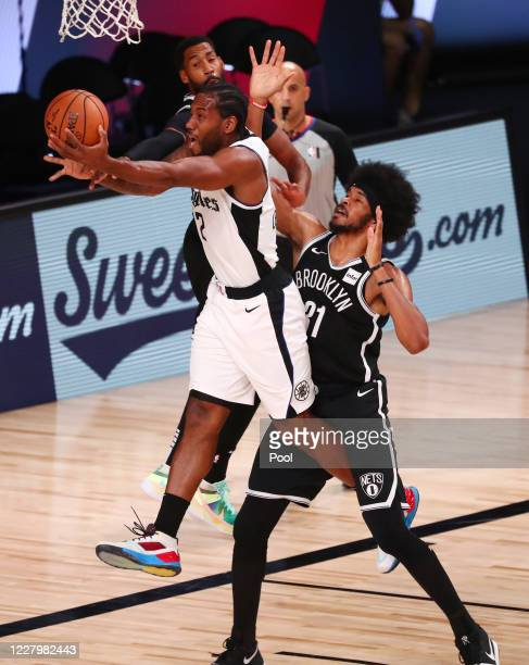 Kawhi Leonard of the LA Clippers shoots against Jarrett Allen of the Brooklyn Nets in the first half of a NBA basketball game at AdventHealth Arena...