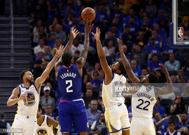 Kawhi Leonard of the LA Clippers shoots over Stephen Curry, Omari Spellman, and Glenn Robinson III of the Golden State Warriors at Chase Center on...