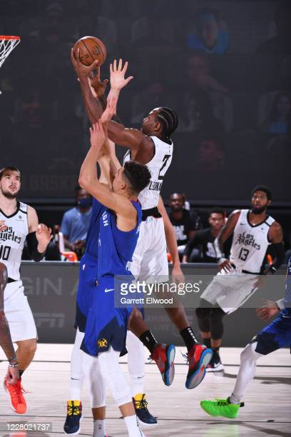 Kawhi Leonard of the LA Clippers shoots the ball against the Denver Nuggets on August 12 2020 at the AdventHealth Arena at in Orlando Florida NOTE TO...