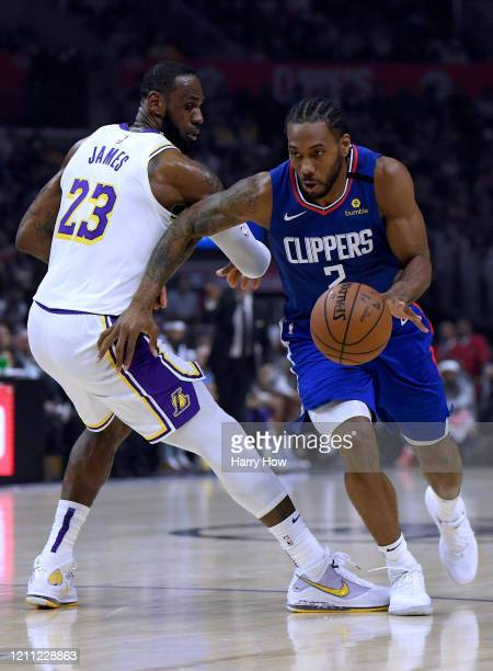 Kawhi Leonard of the LA Clippers spins away from LeBron James of the Los Angeles Lakers during a 112103 Lakers win at Staples Center on March 08 2020...