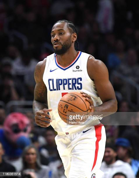 Kawhi Leonard of the LA Clippers takes the ball up court during a 111-91 Denver Nuggets preseason win at Staples Center on October 10, 2019 in Los...