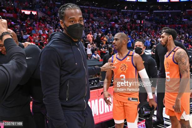 Kawhi Leonard of the LA Clippers talks to Chris Paul of the Phoenix Suns after the game during Game 6 of the Western Conference Finals of the 2021...