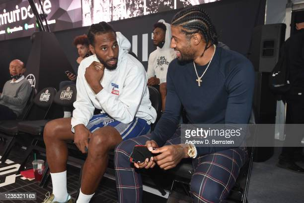 Kawhi Leonard of the LA Clippers talks to teammate Paul George during the LA Clippers ground breaking on Intuit Dome on September 17, 2021 in...