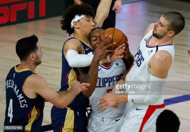 Kawhi Leonard of the LA Clippers tangles with Frank Jackson of the New Orleans Pelicans as JJ Redick of the New Orleans Pelicans and Ivica Zubac of...