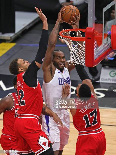 Kawhi Leonard of the LA Clippers tries to get off a shot against Daniel Gafford and Garrett Temple of the Chicago Bulls at the United Center on...