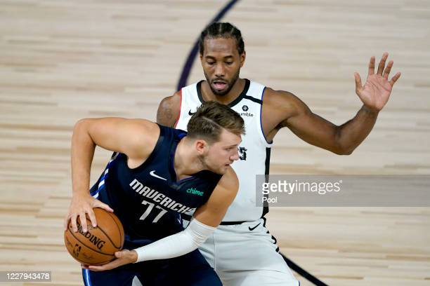 Kawhi Leonard of the Los Angeles Clippers applies pressure on Luka Doncic of the Dallas Mavericks during the second half of an NBA basketball game at...