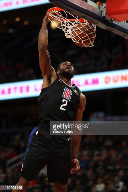 Kawhi Leonard of the Los Angeles Clippers dunks against the Washington Wizards during the first half at Capital One Arena on December 8, 2019 in...