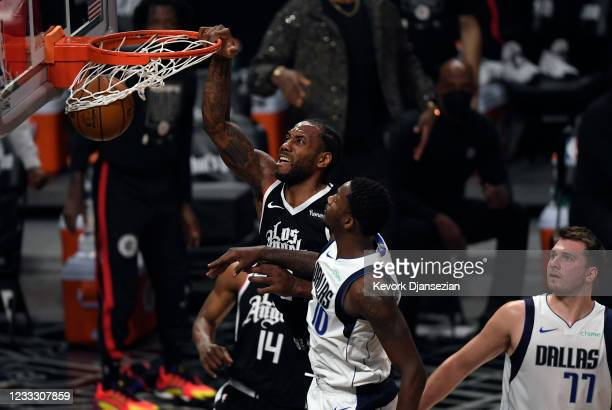 Kawhi Leonard of the Los Angeles Clippers dunks the ball against Dorian Finney-Smith of the Dallas Mavericks during the first half of Game Seven of...