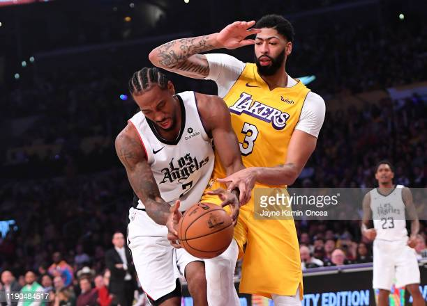 Kawhi Leonard of the Los Angeles Clippers is fouled by Anthony Davis of the Los Angeles Lakers as he drives to the basket in the first half of the...