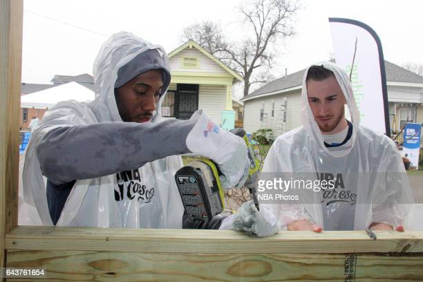 Kawhi Leonard of the San Antonio Spurs and Gordon Hayward of the Utah Jazz participates during the NBA Cares Day of Service as part of 2017 AllStar...
