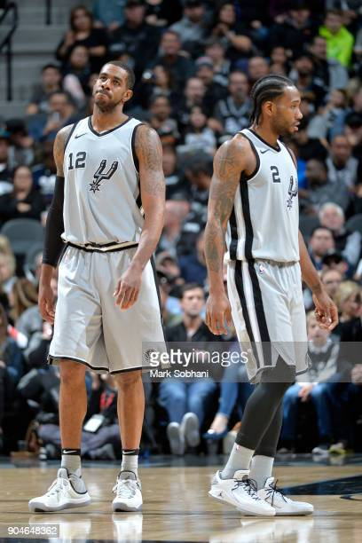 Kawhi Leonard of the San Antonio Spurs and LaMarcus Aldridge of the San Antonio Spurs look on during the game against the Denver Nuggets on January...