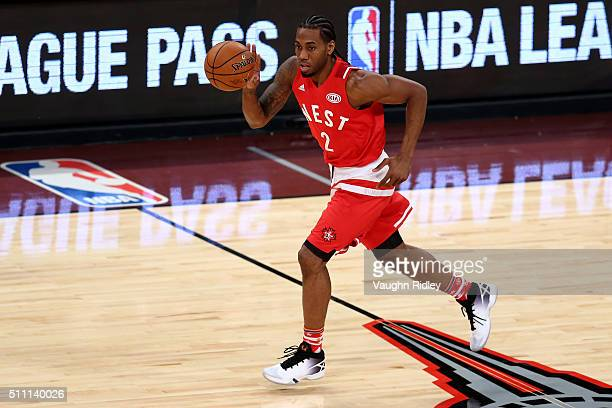 Kawhi Leonard of the San Antonio Spurs and the Western Conference brings the ball up court in the second half against the Eastern Conference during...