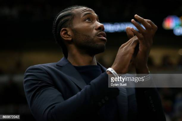 Kawhi Leonard of the San Antonio Spurs applauds from the bench in the third quarter against the Chicago Bulls at the United Center on October 21 2017...