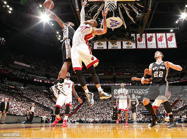 Kawhi Leonard of the San Antonio Spurs attempts a dunk over Chris Andersen of the Miami Heat during Game Four of the 2014 NBA Finals at American...