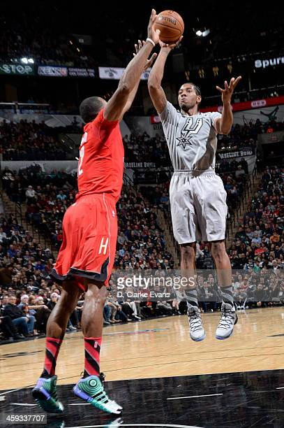 Kawhi Leonard of the San Antonio Spurs attempts a shot against Dwight Howard of the Houston Rockets on December 25 2013 at the ATT Center in San...