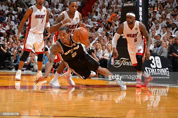 Kawhi Leonard of the San Antonio Spurs attempts to control the ball against the Miami Heat during Game Six of the 2014 NBA Finals on June 12 2014 at...