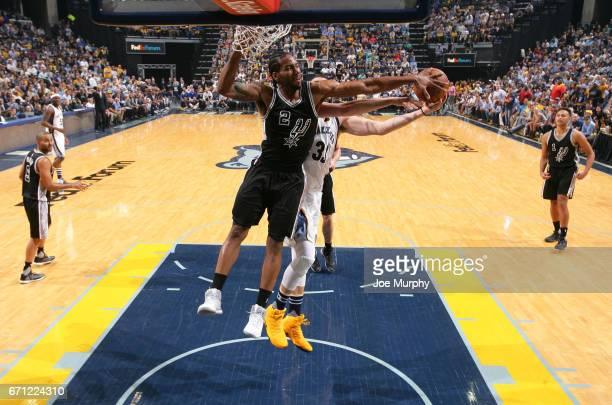 Kawhi Leonard of the San Antonio Spurs blocks a shot against the Memphis Grizzlies for a photo before the game against the San Antonio Spurs during...