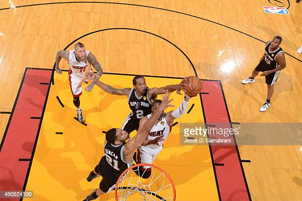 Kawhi Leonard of the San Antonio Spurs blocks a shot against the Miami Heat during Game Six of the 2014 NBA Finals on June 12 2014 at American...