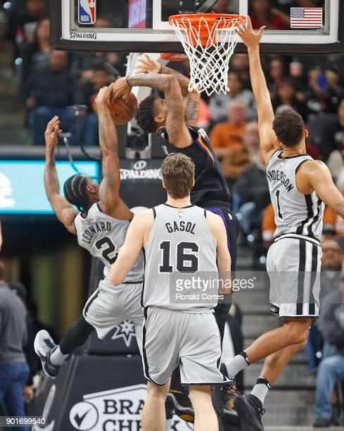 Kawhi Leonard of the San Antonio Spurs blocks a shot attempt of Marquese Chriss of the Phoenix Suns at ATT Center on January 05 2018 in San Antonio...