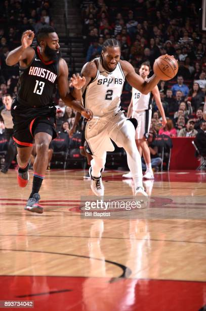 Kawhi Leonard of the San Antonio Spurs brings the ball up court against James Harden of the Houston Rockets on December 15 2017 at the Toyota Center...