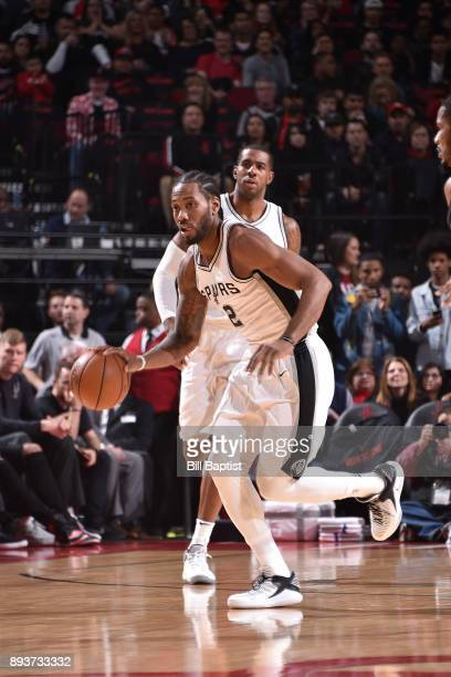 Kawhi Leonard of the San Antonio Spurs brings the ball up court against the Houston Rockets on December 15 2017 at the Toyota Center in Houston Texas...