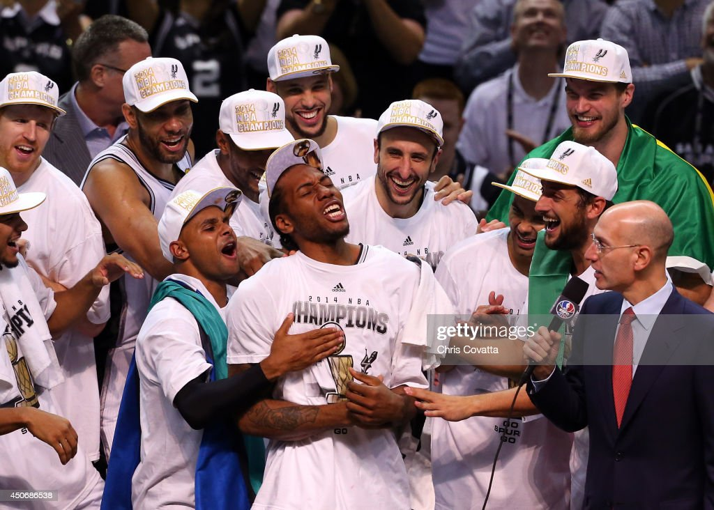 Kawhi Leonard #2 of the San Antonio Spurs celebrates after being named the MVP following Game Five of the 2014 NBA Finals against the Miami Heat at the AT&T Center on June 15, 2014 in San Antonio, Texas.