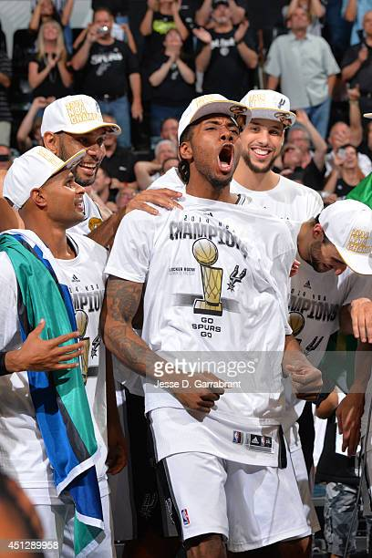 Kawhi Leonard of the San Antonio Spurs celebrates winning the 2014 NBA Championship after Game Five of the 2014 NBA Finals against the Miami Heat on...