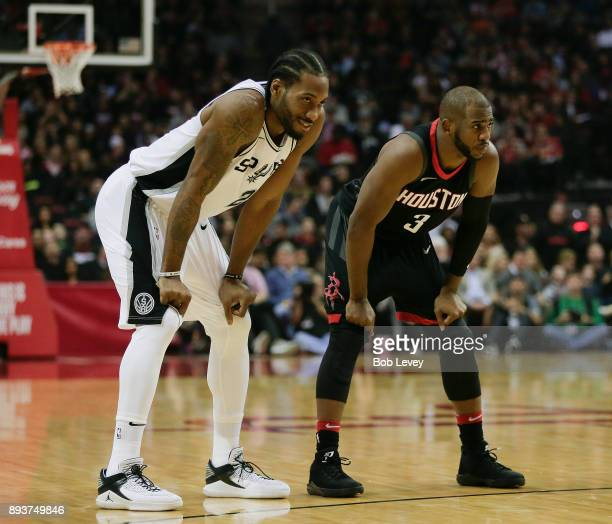 Kawhi Leonard of the San Antonio Spurs Chris Paul of the Houston Rockets talk at Toyota Center on December 15 2017 in Houston Texas NOTE TO USER User...