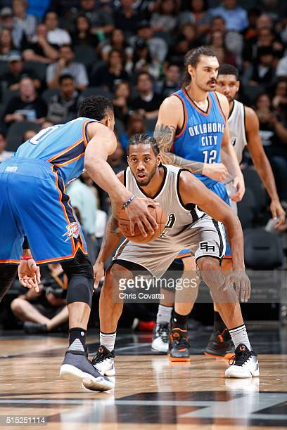 Kawhi Leonard of the San Antonio Spurs defends the basket against the Oklahoma City Thunder during the game on March 12 2016 at ATT in San Antonio...