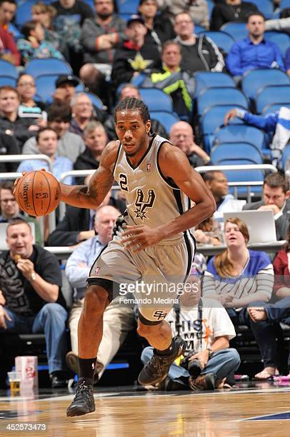 Kawhi Leonard of the San Antonio Spurs dribbles up the court against the Orlando Magic during the game on November 29 2013 at Amway Center in Orlando...