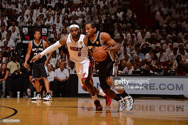 Kawhi Leonard of the San Antonio Spurs drives against LeBron James of the Miami Heat during Game Three of the 2014 NBA Finals on June 10 2014 at...