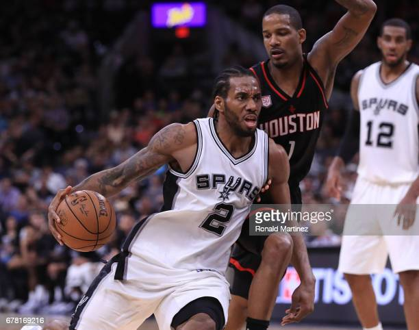 Kawhi Leonard of the San Antonio Spurs drives against Trevor Ariza of the Houston Rockets during Game Two of the NBA Western Conference SemiFinals at...