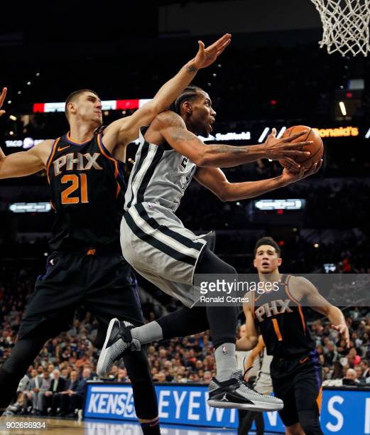 Kawhi Leonard of the San Antonio Spurs drives past Alex Len of the Phoenix Suns at ATT Center on January 05 2018 in San Antonio Texas NOTE TO USER...