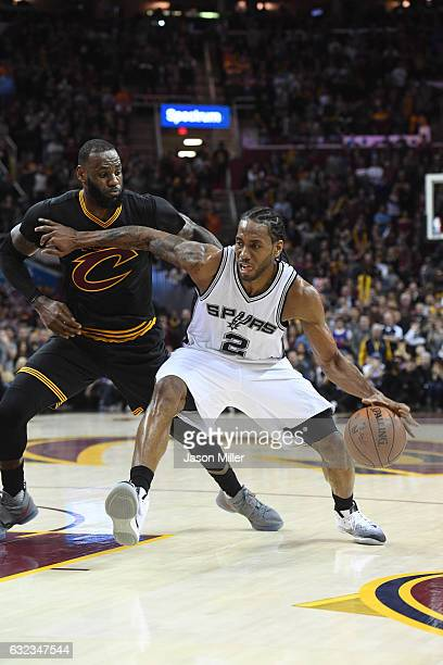 Kawhi Leonard of the San Antonio Spurs drives past LeBron James of the Cleveland Cavaliers during the second half at Quicken Loans Arena on January...