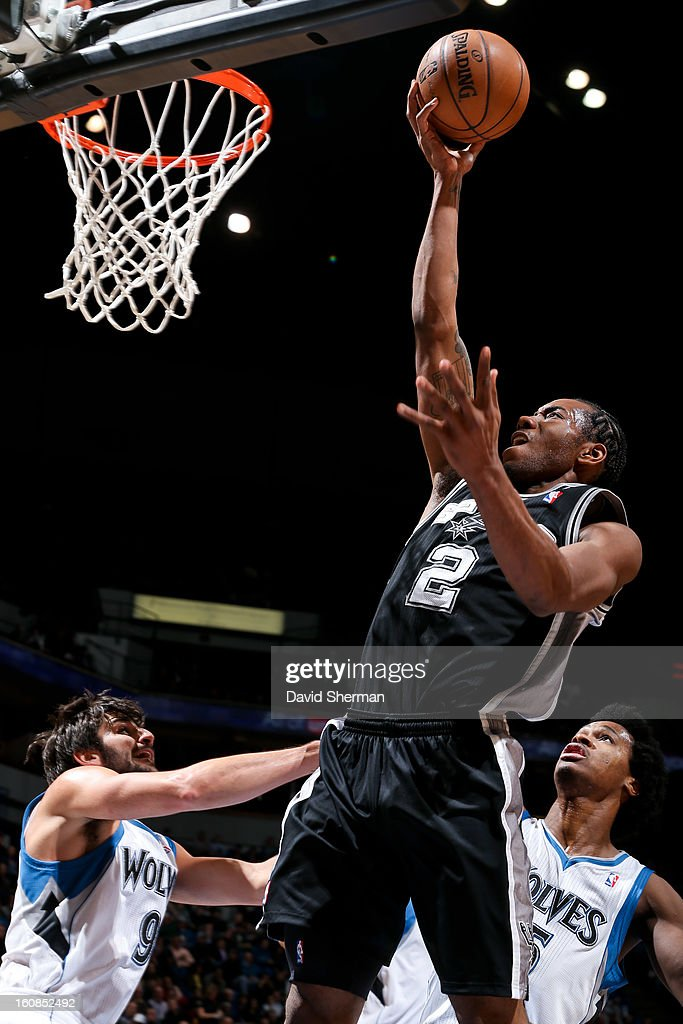 Kawhi Leonard #2 of the San Antonio Spurs drives to the basket against Ricky Rubio #9 of the Minnesota Timberwolves on February 6, 2013 at Target Center in Minneapolis, Minnesota.