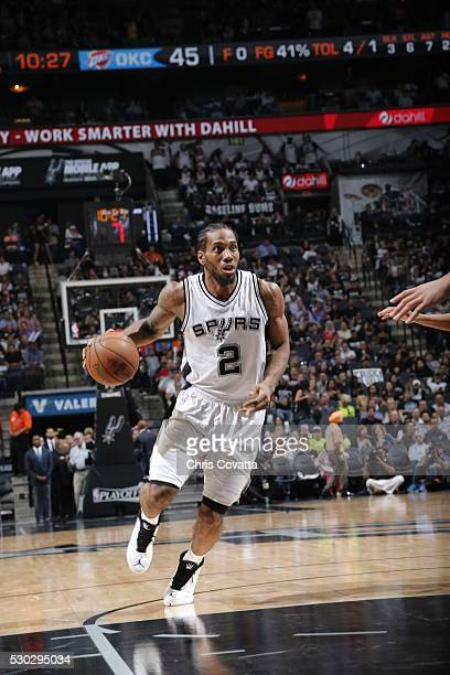 Kawhi Leonard of the San Antonio Spurs drives to the basket against the Oklahoma City Thunder in Game Five of the Western Conference Semifinals...