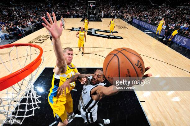 Kawhi Leonard of the San Antonio Spurs drives to the basket against the Denver Nuggets on January 13 2018 at the ATT Center in San Antonio Texas NOTE...