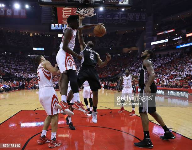 Kawhi Leonard of the San Antonio Spurs dunks against Clint Capela of the Houston Rockets during Game Three of the NBA Western Conference SemiFinals...