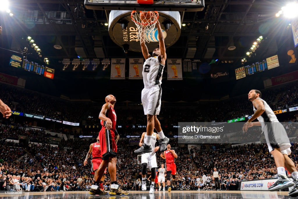 Kawhi Leonard #2 of the San Antonio Spurs dunks against the Miami Heat during Game Three of the 2013 NBA Finals on June 11, 2013 at AT&T Center in San Antonio, Texas.