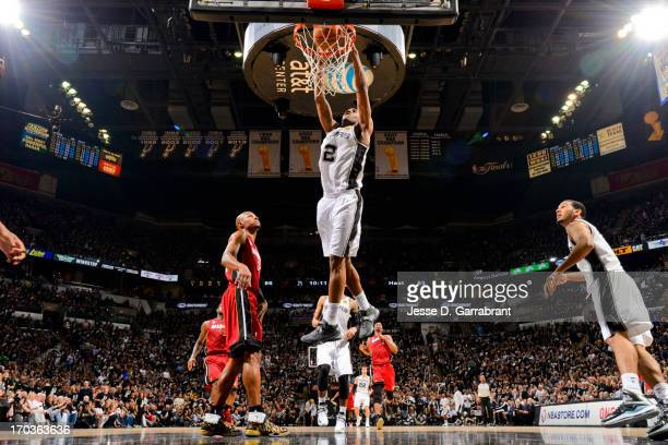 Kawhi Leonard of the San Antonio Spurs dunks against the Miami Heat during Game Three of the 2013 NBA Finals on June 11 2013 at ATT Center in San...